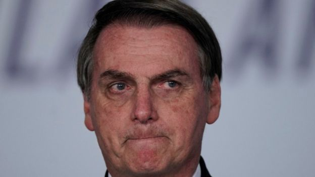 Mr Bolsonaro looking disappointed at an event on March 25