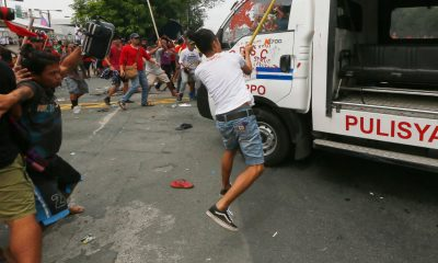 Police van runs over protesters in anti-US rally in US embassy in Manila